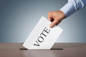 A hand casting vote