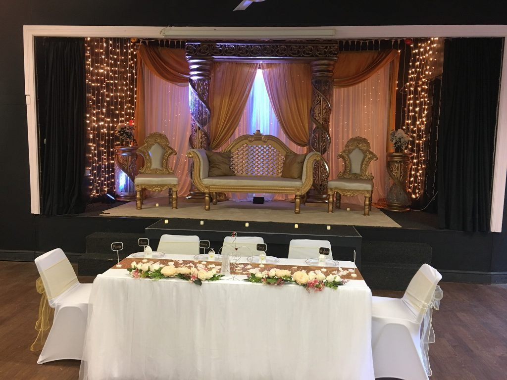 Stage set for wedding at The Pavilion