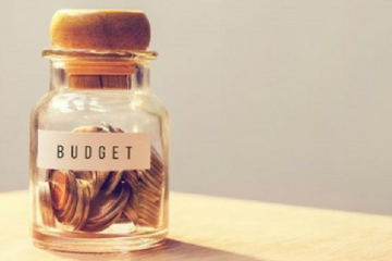 Money in a jar labelled budget